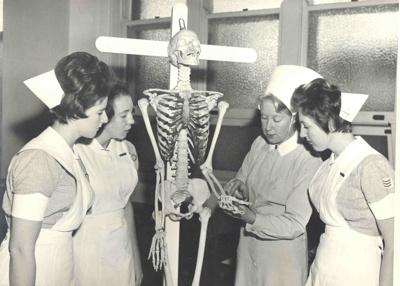 Nurses studying a skeleton